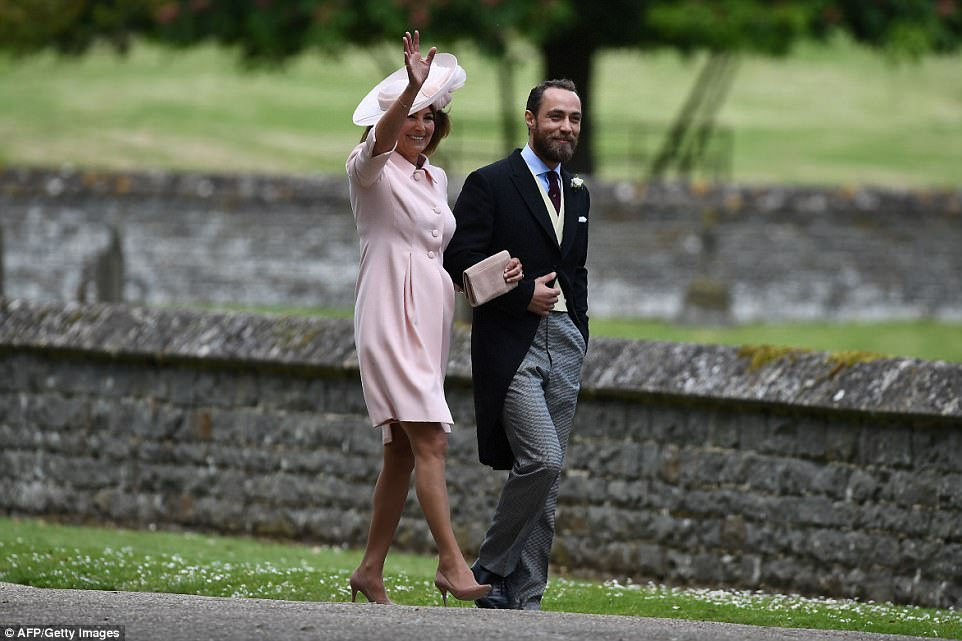 Arrriving at the church in pale pink Catherine Walker, mother of the bride Carole Middleton