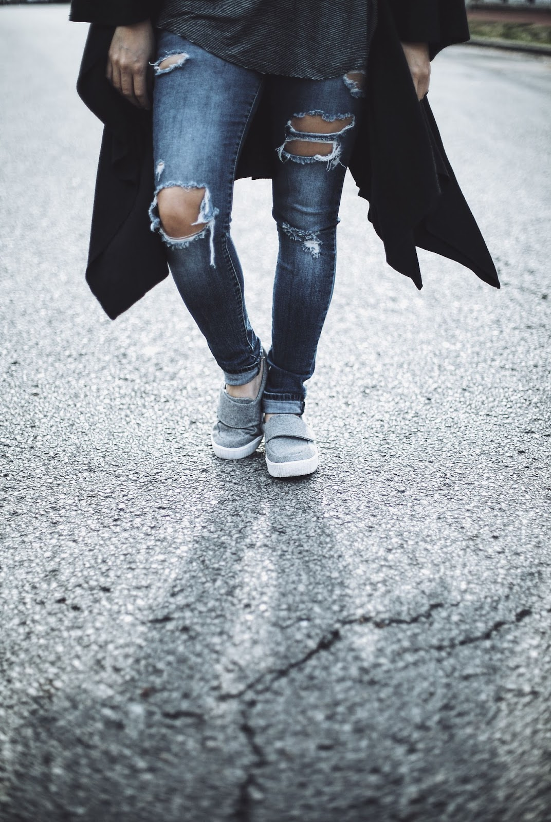 Grey sneakers ripped denim jeans
