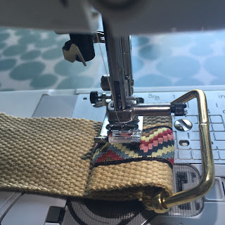 Affix webbing to hardware with sewing machine