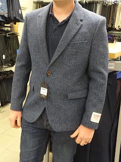 harris tweed jacket on man in store