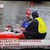 Furacão Harvey: Sacerdote em caiaque cruza inundações para celebrar Missa com fiéis