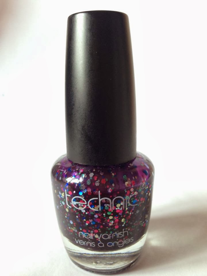 A bottle of purple glitter nail varnish