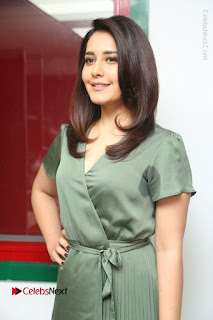 Actress Raashi Khanna Stills in Green Short Dress at Mirchi 95 Suno Aur Mercedes Jeeto Contest  0086.JPG