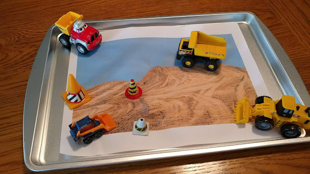 Printed scene with toy construction equipment