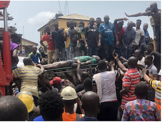OMG!!! Woman commits suicide after losing two children in Lagos building collapse