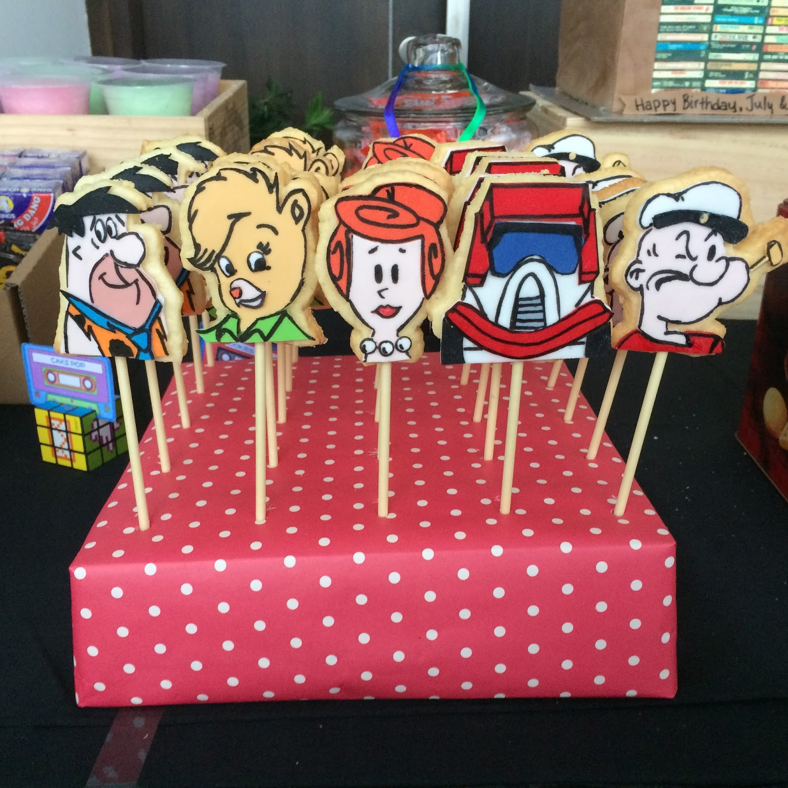 80 S Cartoons Cookie Pops Displayed On A Diy Pop Stand