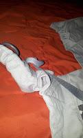 porte-bébé préformé physiologique bretelles boucle serrage haut des bretelles