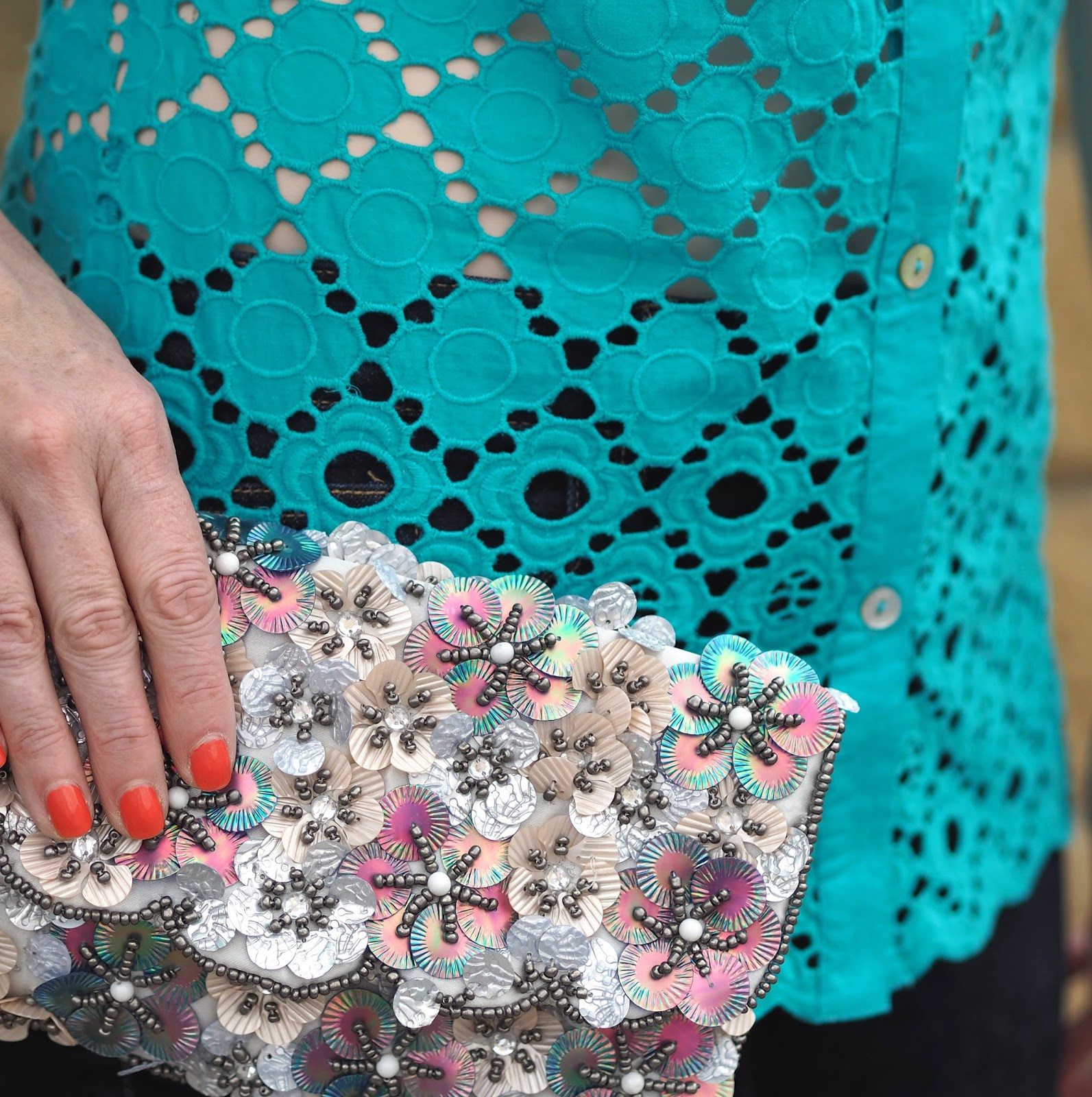 Turquoise broderie anglais top with skinny jeans and metallic floral embellished clutch bag