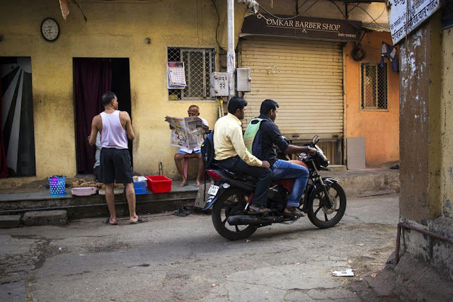worli koliwada, morning, waking up, reading, riding, mumbai, india, street, streetphoto, street photography , incredible india,