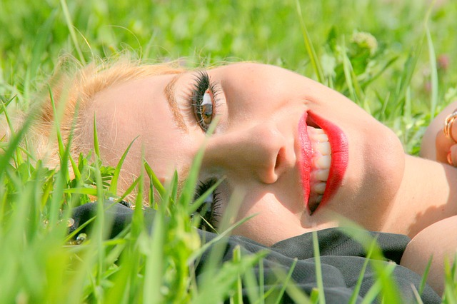 Blonde Smiling in the grass