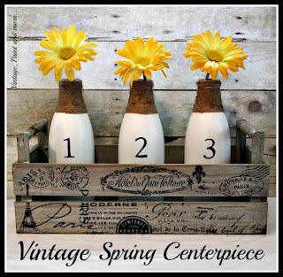 painted, stenciled and twine wrapped milk bottles made into vases and placed in a French graphic box for a vintage Spring centerpiece