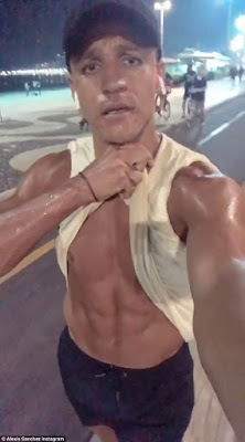 Alexis Sanchez shows off his six-pack during beach training session as he primes himself for Manchester United pre-season in Rio de Janeiro