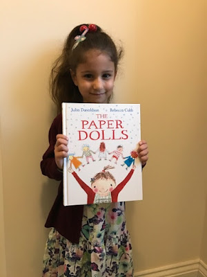 Child dressed as the girl from the Paper Dolls book