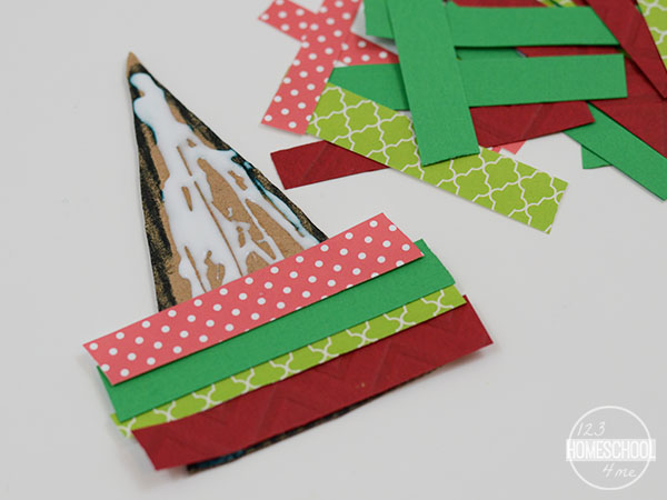 glue strips of paper onto the triangle to make a cute Chrsitmas Craft for Kids