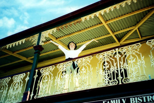 woman on second floor balcony of an Australian pub