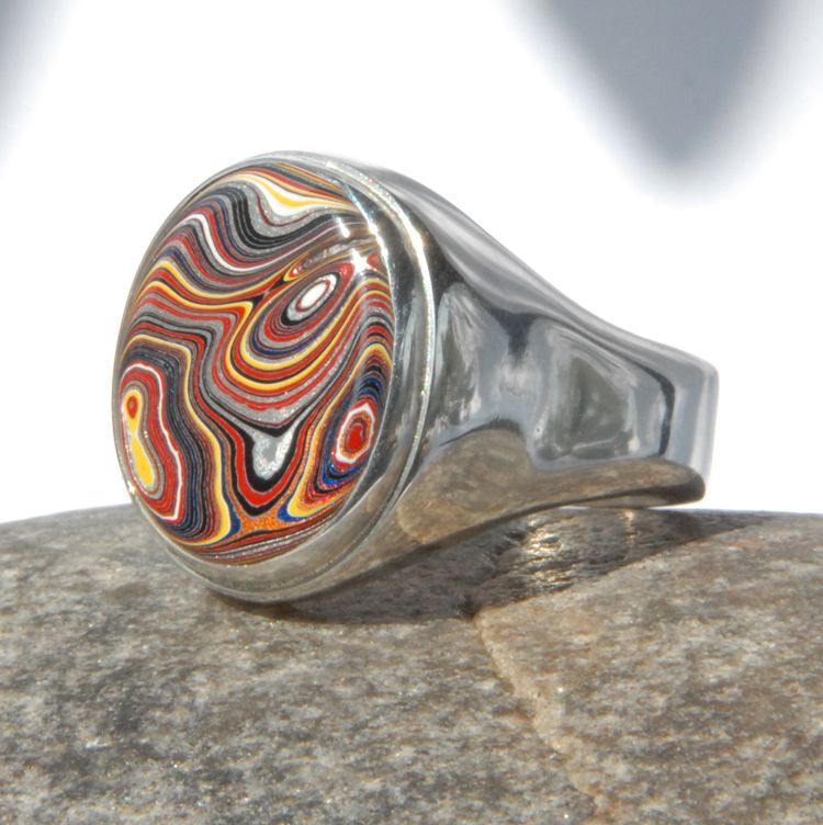 Fordite set on a Sterling Silver Hollow Ring Pendants by Sasha Garrett