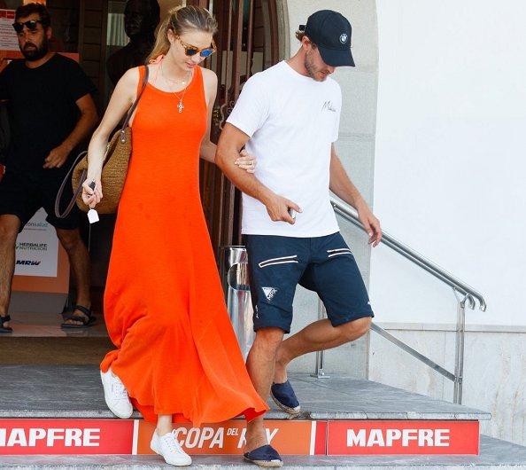 Pierre Casiraghi and Beatrice Borromeo in Palma de Mallorca. Beatrice Borromeo wearing a orange maxi dress