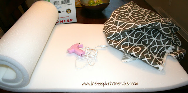 Foam, glue gun and fabric for making a DIY no sew bench cushion cover