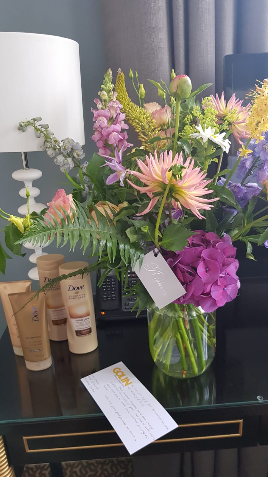 Dove's gradual tanning products and beautiful flowers left in hotel room at Dove bloggers spa retreat
