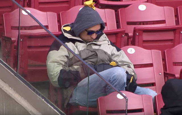 Sleeping MLB fan has nachos on his head