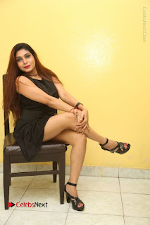 Tollywood Upcoming Actress Pooja Roshan Stills in Black Short Dress at Plus 1 Movie Trailer Launch  0318.JPG