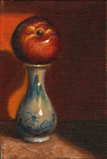 Oil painting of a red and yellow nectarine on a blue and white miniature vase.