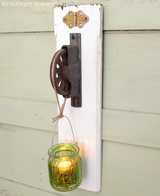 use an old pulley and scrap wood as a tea light holder