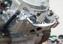 f) KIPS (Kawasaki Integrated Powervalve system)