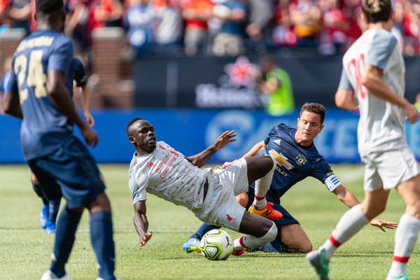 Said Mane #10 of Liverpool collides with Ander Herrera #21 Manchester United during first half of the International Champions Cup 2018 at Michigan Stadium on July 28, 2018 in Ann Arbor, Michigan.