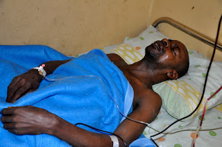 man laying in hospital