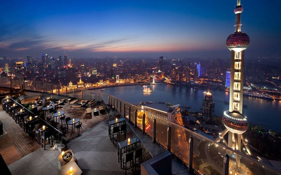 The World's 30 Best Rooftop Bars… Everyone Should Drink At #9 At Least Once. - The 58th floor view in the Ritz-Carlton Shanghai in China.