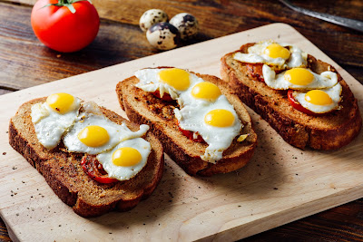 sourdough toast with tomato,chickpea and egg