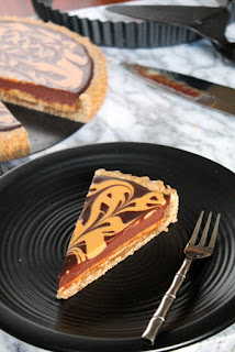 http://www.thespiffycookie.com/2015/11/21/chocolate-peanut-butter-gingerbread-tart/