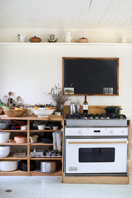 Open shelving and range in minimal farmhouse kitchen - found on Hello Lovely