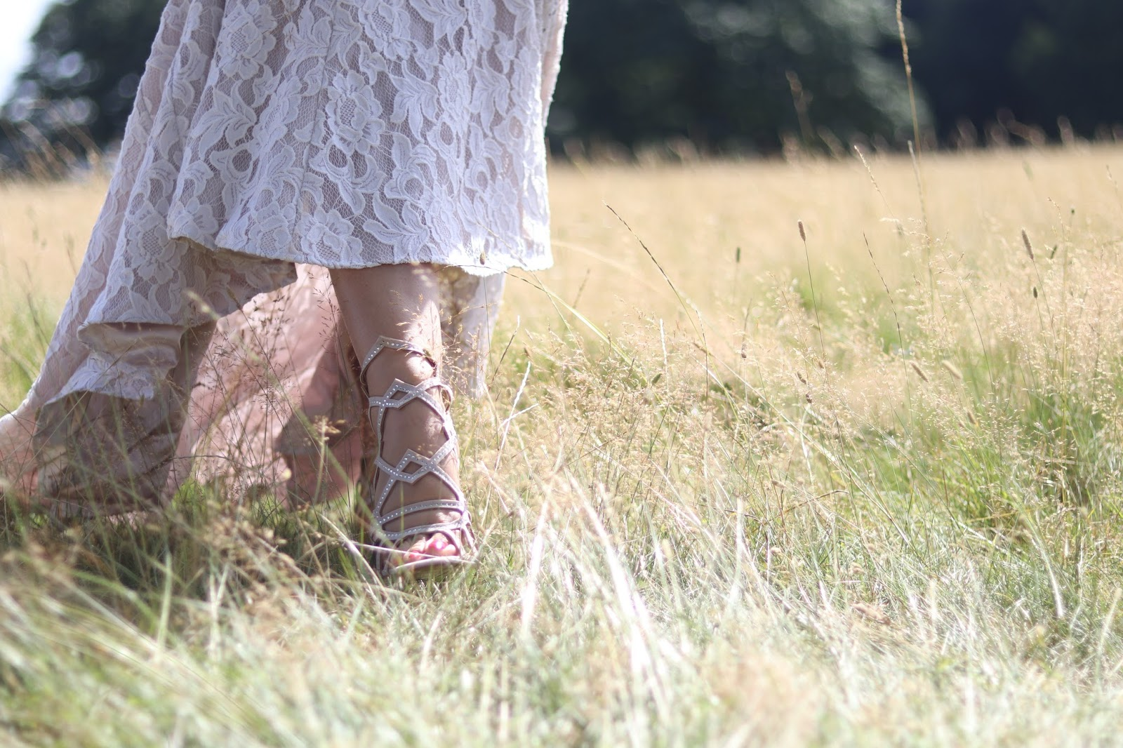 Katie Heath wearing a Jacques Vert Wedding Dress and Missguided Laser cut heels in Richmond Park Meadow