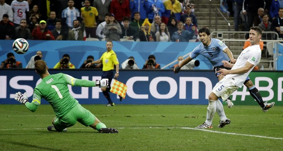 Uruguay's Luis Suarez scores his side's second goal during the group D World Cup soccer match between Uruguay and England at the Itaquerao Stadium in Sao Paulo, Brazil, Thursday, June 19, 2014.