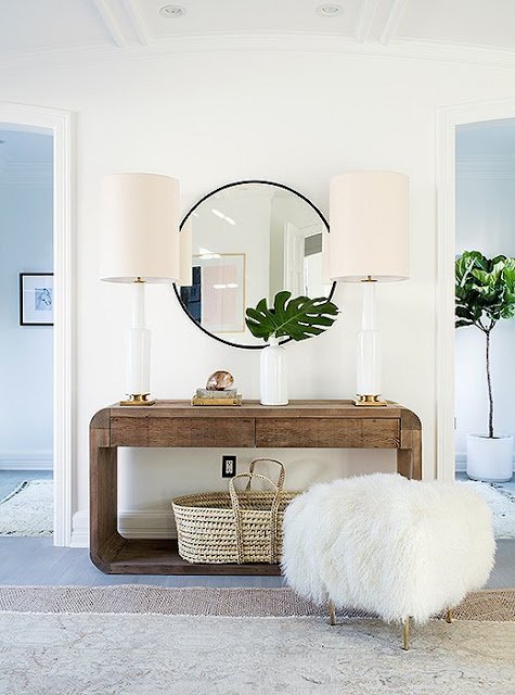 Beautiful the two table lamps on the console with rounded edges | Erin Fetherston's West Hollywood home.