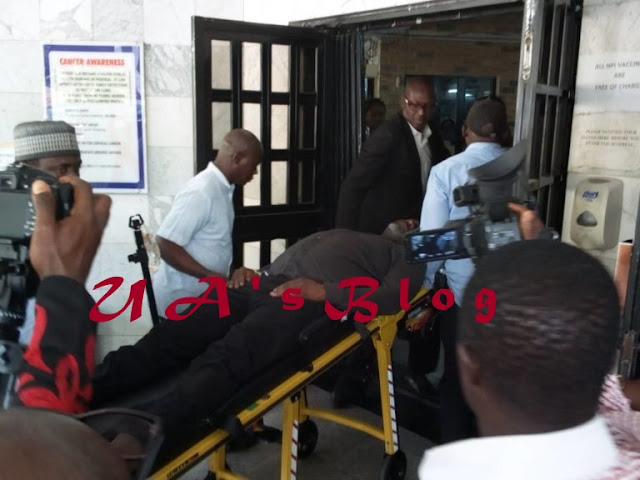 Police drag Senator to court as he appears on stretcher