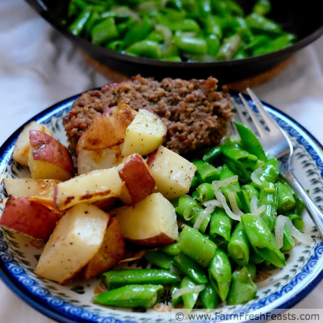 a square image of crisply cooked sugar snap peas with roasted potatoes and meatloaf