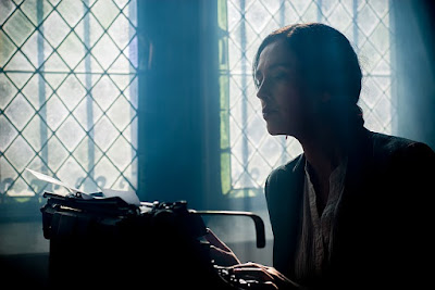woman typing on typewriter