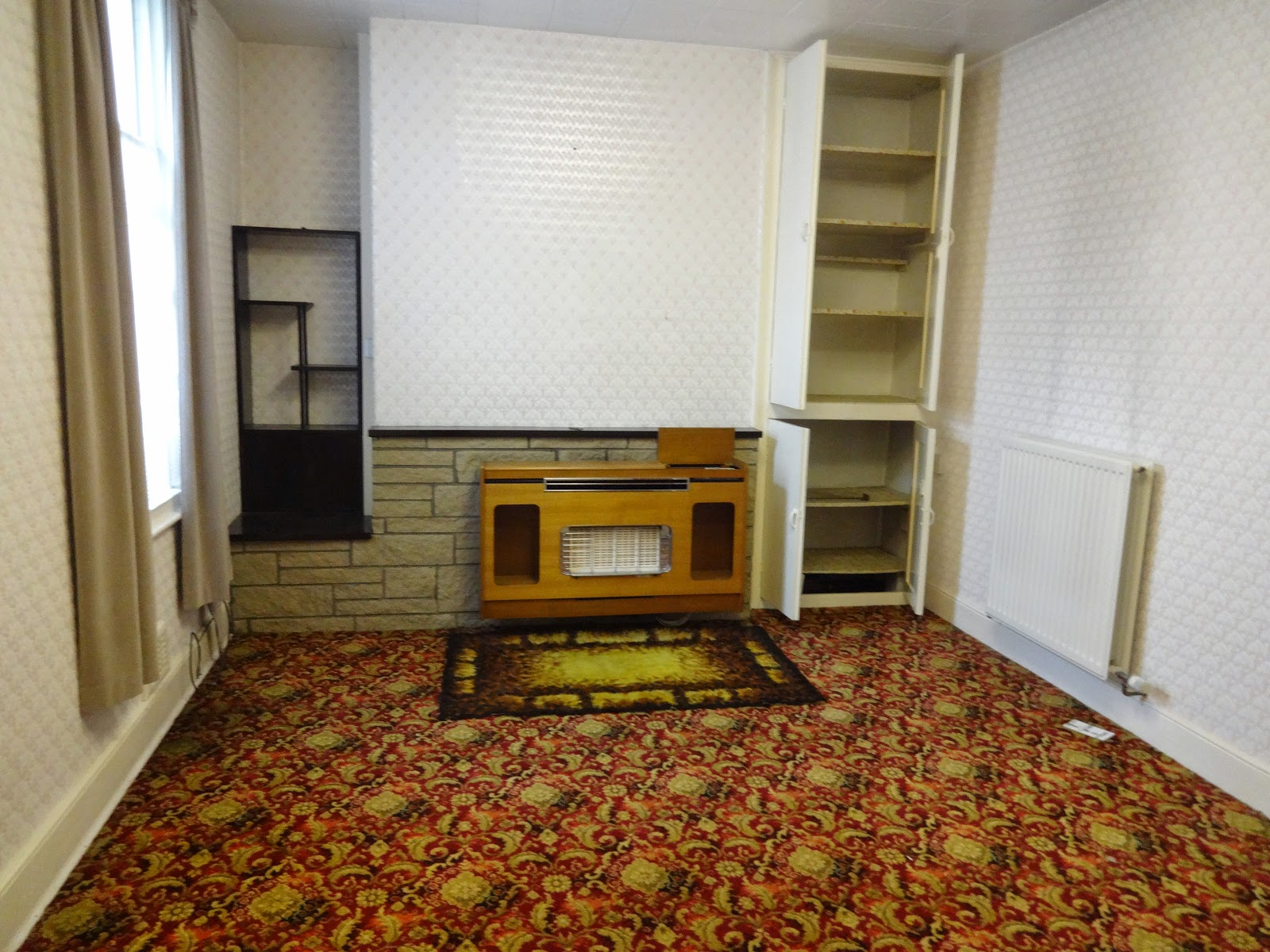 retro dining room with patterned carpet and old back boiler
