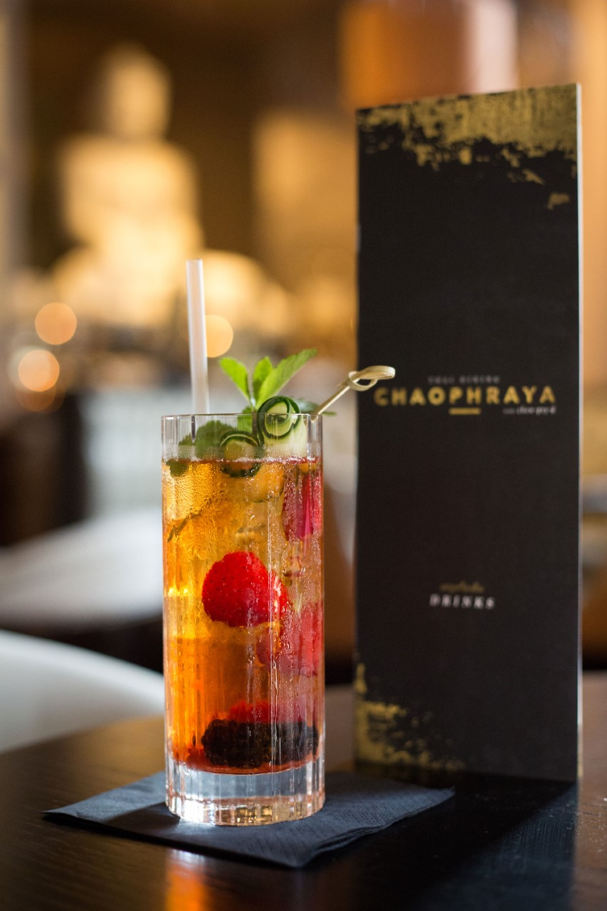 close up of a organge cocktail from Chaophraya