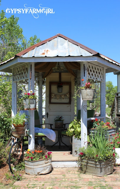 rustic gazebo with spring flowers