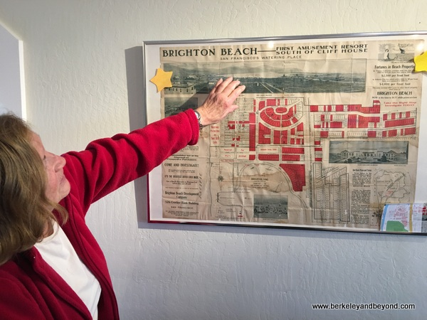 Kathleen Manning explains display in Pacifica Coastside Museum in Pacifica, California