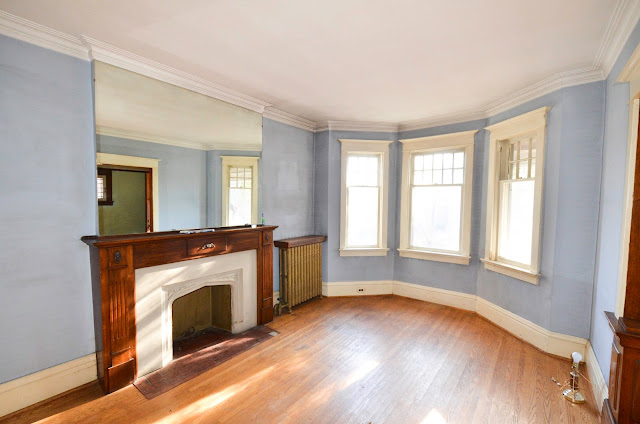 #projectrad: 1909 powder blue living room with fireplace and bay windows