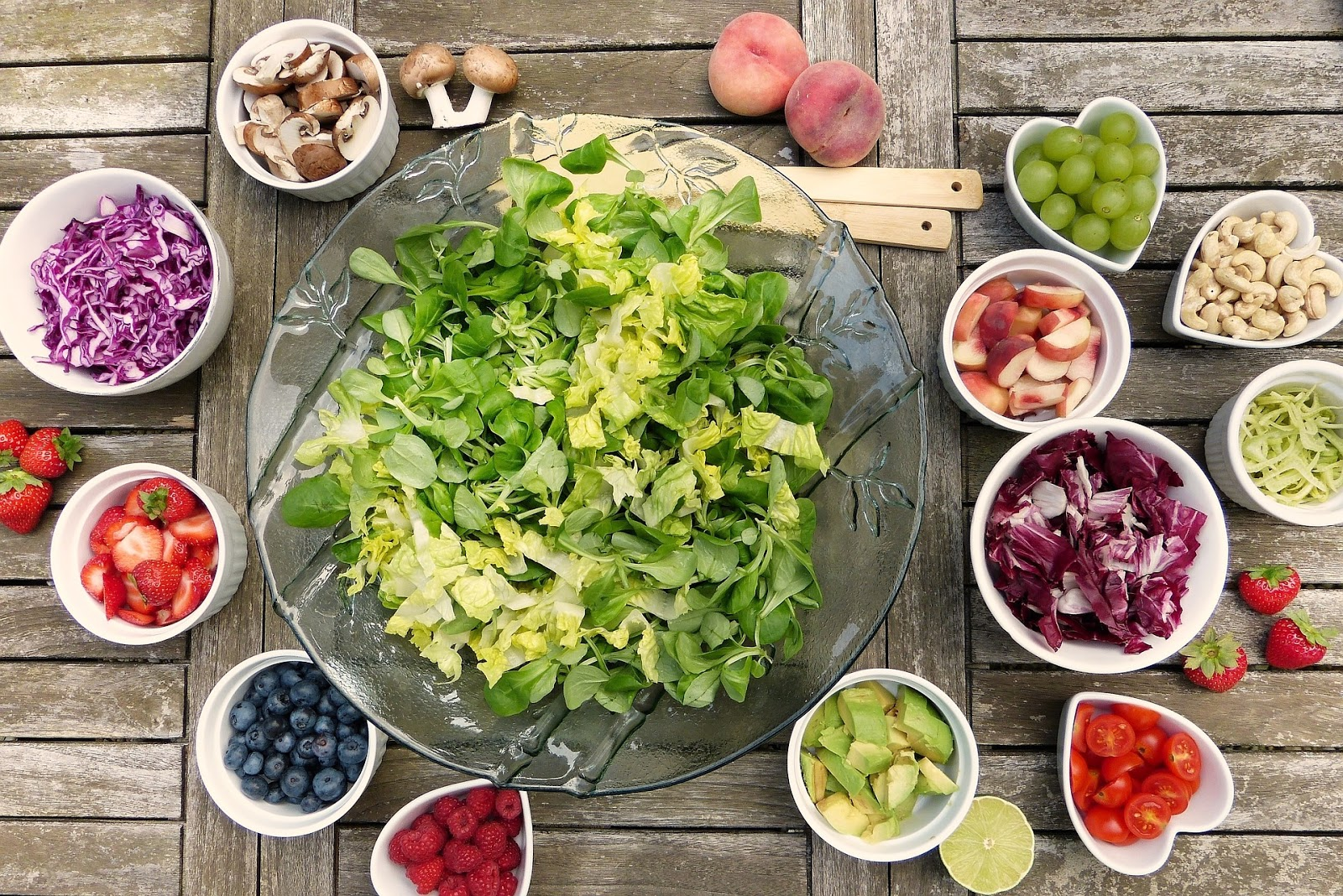 Salad and berries, food rich in vitamins