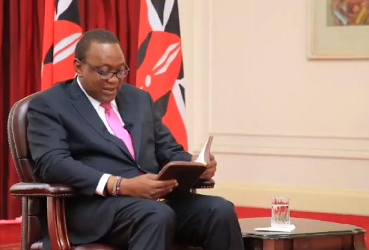 President Kenyatta Reading the Bible