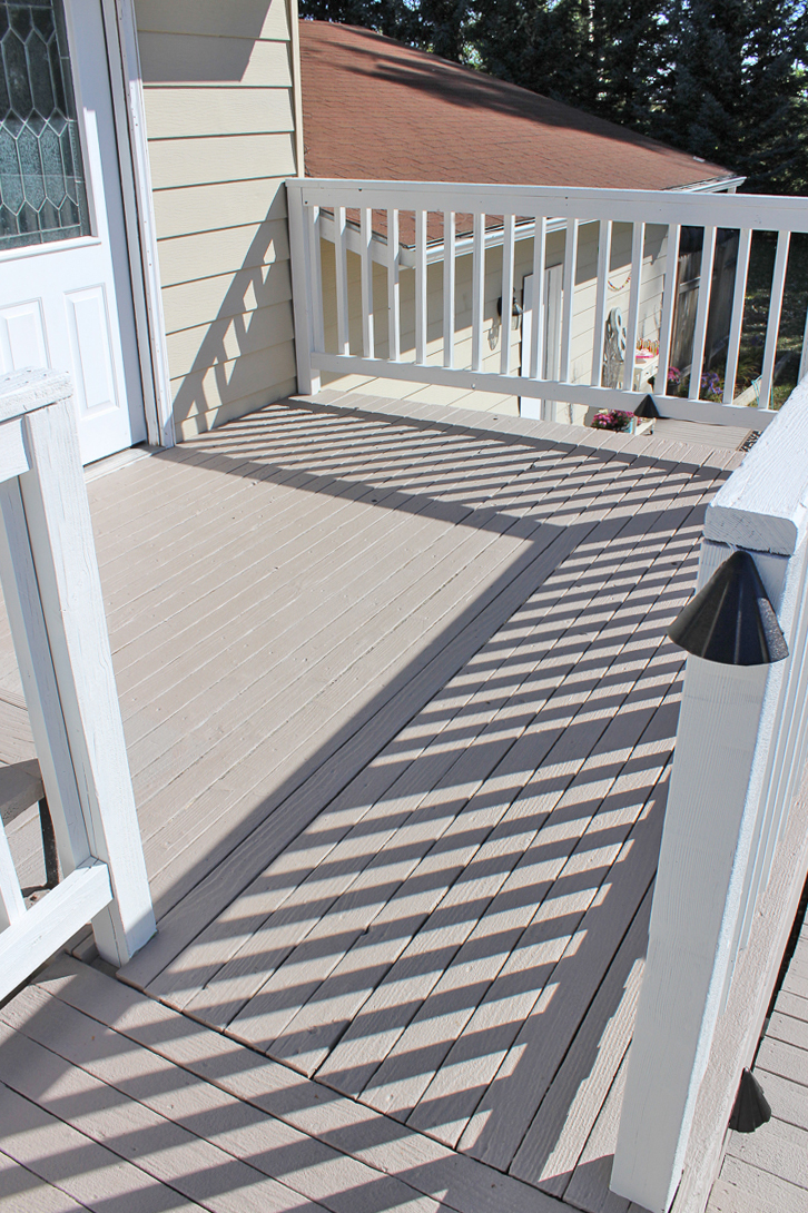 This wooden deck was refinished with opaque paint and looks amazing!