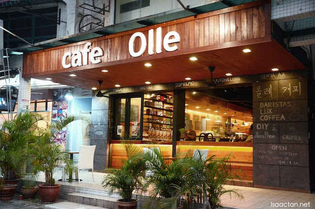 Nicely lit exterior of Cafe Olle