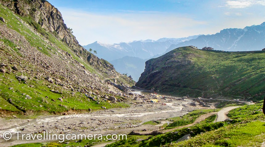 If you are planning a trip to Manali, Rohtang Pass, Kullu, Manikaran or Lahual Spiti, which Photo Journey will give you some glimpses of landscapes you can expect along with some tips on planning the trip. Which includes modes of transportation, right places to stay and things to do around this region. Manali used to be one of my regular destination 8 years back and almost every year I was there during summers as well as winters.Kullu-Manali used to be one of the top 10 destinations in India, when most of the bollywood was only shooting around Kullu valley. Bollywood has been one of the  most important influencer in tourism industry and over the years India has got many new places which were least explored. And some of them are over-hyped because of super-hit bollywood movies :). Still this remains in the top list for folks who like to be around natural beauty. Lot of tourists like Manali, although travelers may want to cross it to hit Spiti or Lahual region. Things have been changing very fast and the places as well.Manali is little far for non-Himachalis as compared to Shimla, especially folks coming from Delhi/Chandigarh and other states of the country. But roads are pretty decent and that's the only way to hit Manali town. Train is available till Kiratpur(Punjab) and from there one needs to book the taxi or opt for bus. Weekly flights are also available from Delhi which would land you at Bhuntar and need to take Taxi. It would take approximately 3 hours from bhuntar to Manali (writing on the basis of road current conditions). So it's always recommended to check road condition when someone plans to visit a place/region.Direct luxury buses are easily available from Delhi, Chandigarh, Shimla or other nearby cities in Himachal, Punjab and Haryana. Most of the Volvo and Mercedes buses take 13-14 hours from Delhi to Manali. These buses take 2-3 stops for food and snacks. And they stop at good places unlike other roadways buses which usually stop at dhabas in relatively bad condition and having dirty places around. After 2016, time to reach Manali will reduce because of high-speed highway which is under construction right now and work is happening at very fast pace. And the best part is that new road will avoid the worst stretch of this whole journey.Summers is definitely a best time to explore Kullu valley and Manali, but keep a note that it would be very crowded during summers. All Hotels and Resorts would be full and highly priced. Personally I don't like visiting places, when tourism is at peak (tourist season). My favorite time is to visit such places in off season and make the best :). So winter is again a good time and there is high probability of experiencing fresh snowfall if you are there between last week of dec and feb.This Photo Journey shares some of the very old photographs with my first point-n-shoot digital camera. I was out with my college friends and idea was to go till Trilokinath Temple which is in Lahual region of Himachal Pradesh.We booked a 4*4 taxi from Bilaspur and headed towards Manali, didn't stop there and hit Trilokinath temple after crossing Rohtang Pass and some amazing & scary landscapes. We were driving on narrowest roads having river flowing on one side and high hill on other. By night we reached Trilokinath temple after some strrugles on the way. There were some landslides which had broken the roads but that experience made the trip memorable :).Spent a night at Trilokinath temple and drove through other parts of Lahual, mainly around Keylong. Amazing landscapes and humble folks. I will be sharing a separate Photo Journey about Lahual experiences.Crossing Rohtang Pass was one of the major challenges of this trip. Traffic jams are big issue on this road and as you reach the other end of pass, melting snow makes your life most difficult. At times, our taxi starting slipping on the frozen roads and it was very scary. Then we started following few army trucks which proved very helpfulOn our back journey, we spent one night in Manali. Stayed in a very basic hotel booked through a friend working in Himachal Tourism. Explored areas around Manali – Old Manali, Hadimba Temple, Naggar Castle, Kullu, Manikaran, Kasol, Vashishth etc. Probably separate Photo Journeys would be useful to share those experiences and specially the Naggar Castle and Fruits valley.Will share more about this journey in next post…
